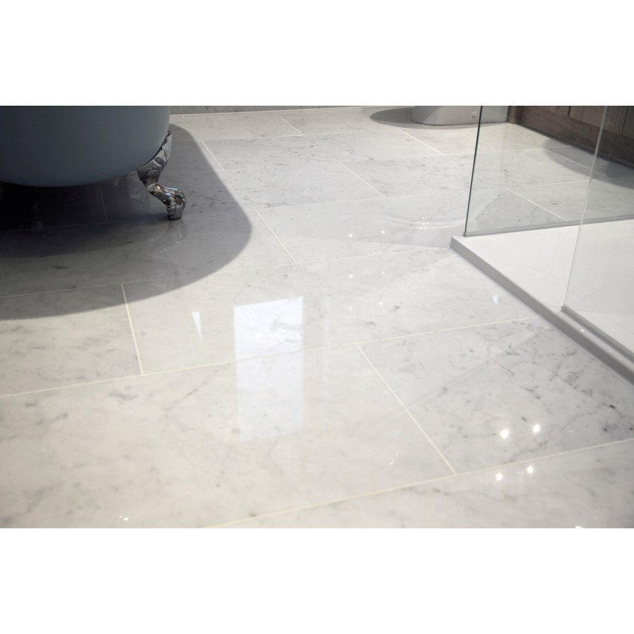 Polished white floor tiles